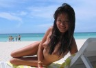 Cute Asian babe naked on the beach