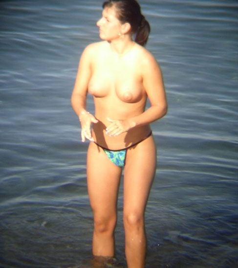 Cutie going topless in the waves