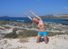 Cutesy blonde poses topless for the camera