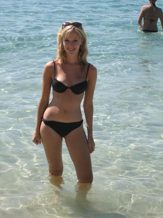 Blonde sweetie in black bikini