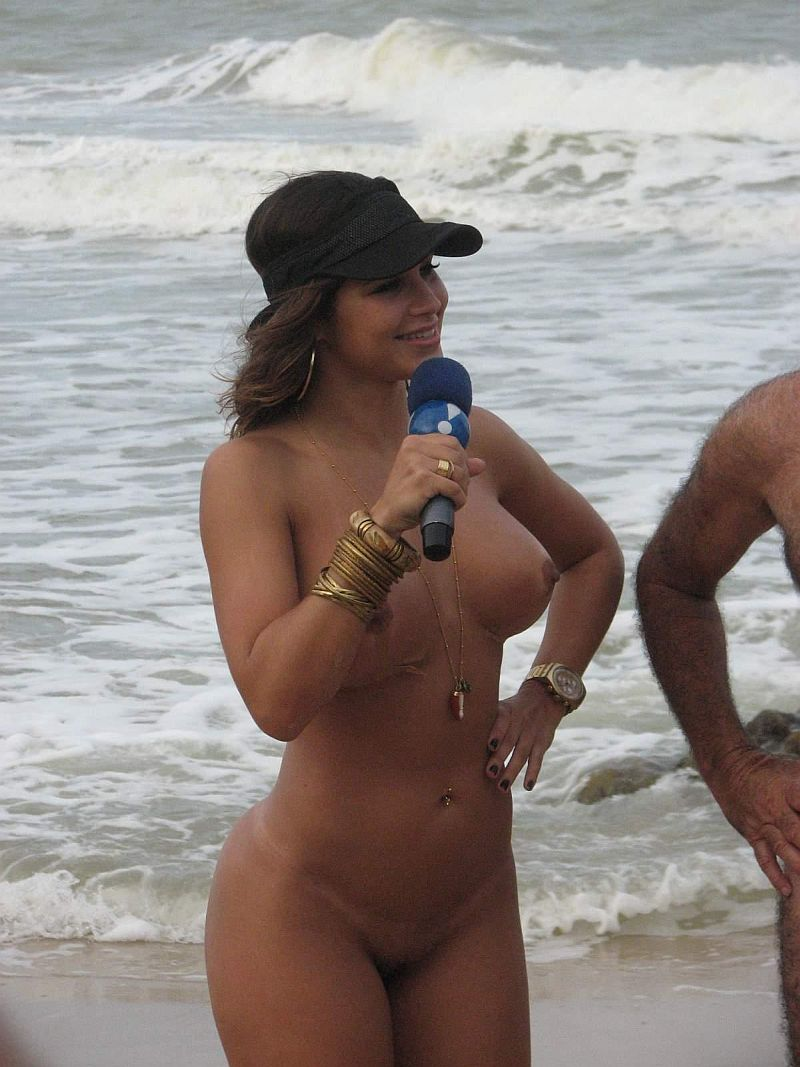 Nude babe playing as reporter at the beach