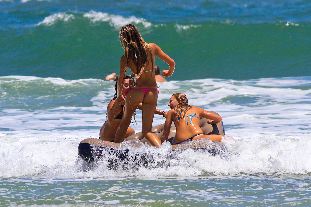Naughty teens having fun at the beach