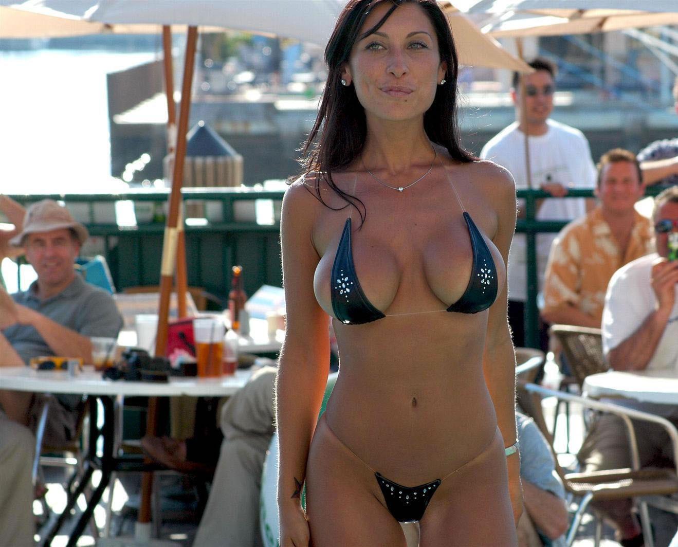 Sexy bikini babe exposing her stunning body