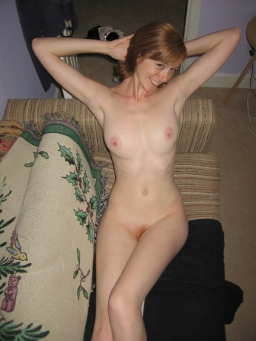 Nudist redhead girl resting at home