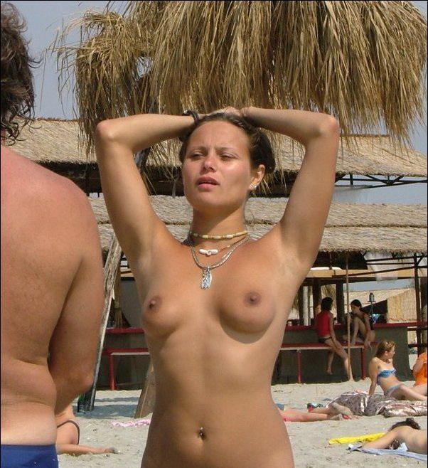 Topless babe on a sunny beach