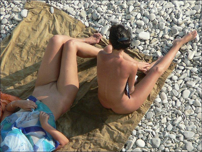 Teen friends enjoying the warm sun on their naked bodies
