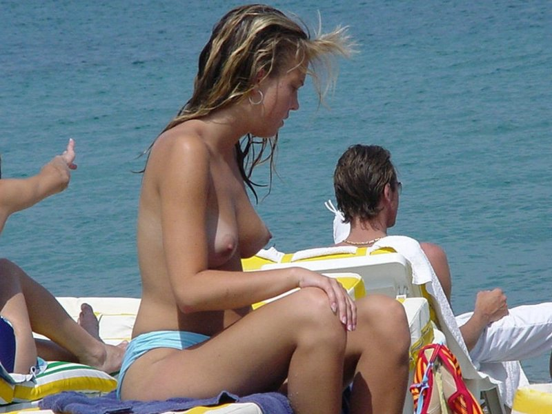 This gorgeous babe with pert tits loves the beach