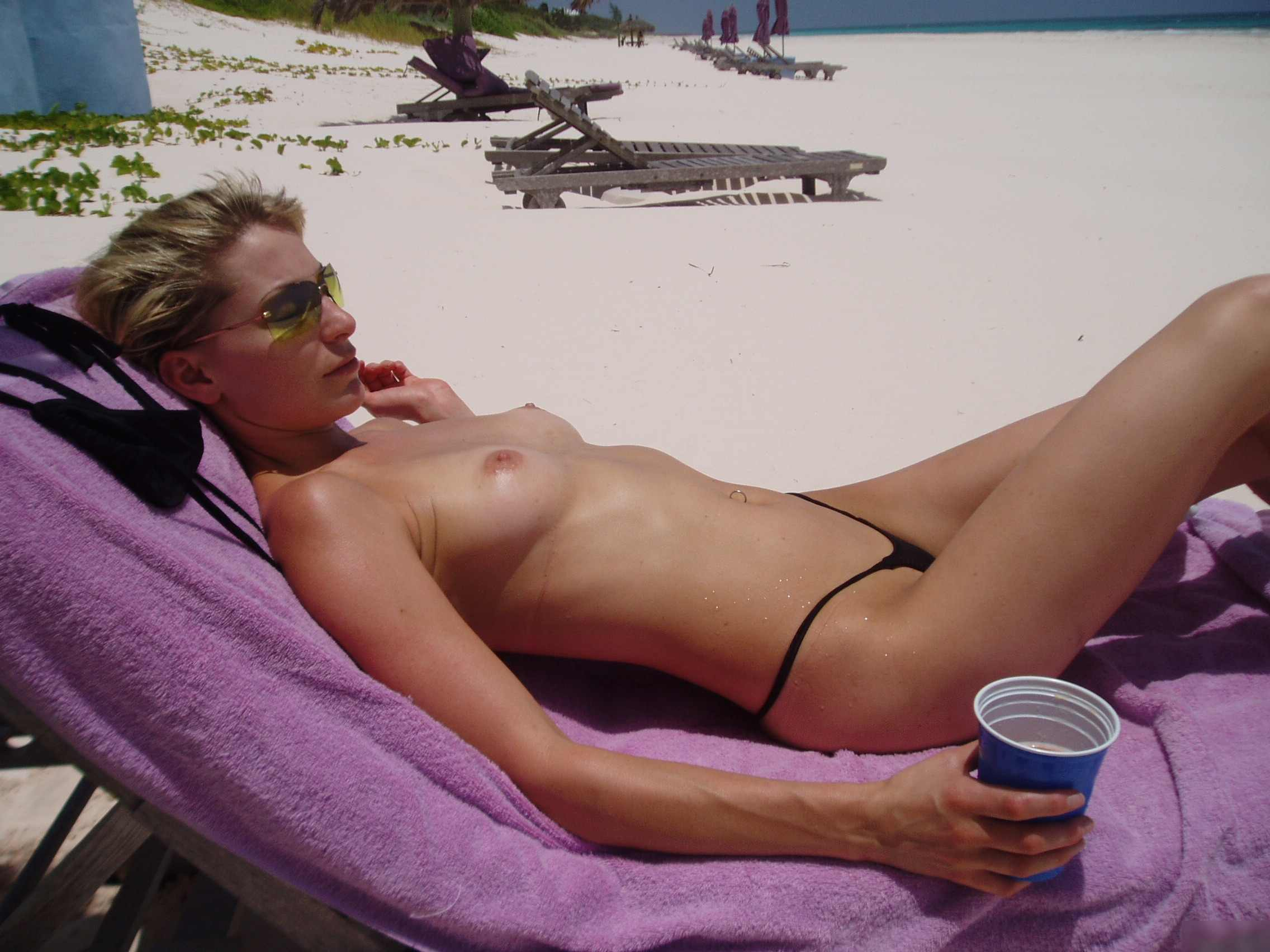 Topless classy lady enjoying a sunny day