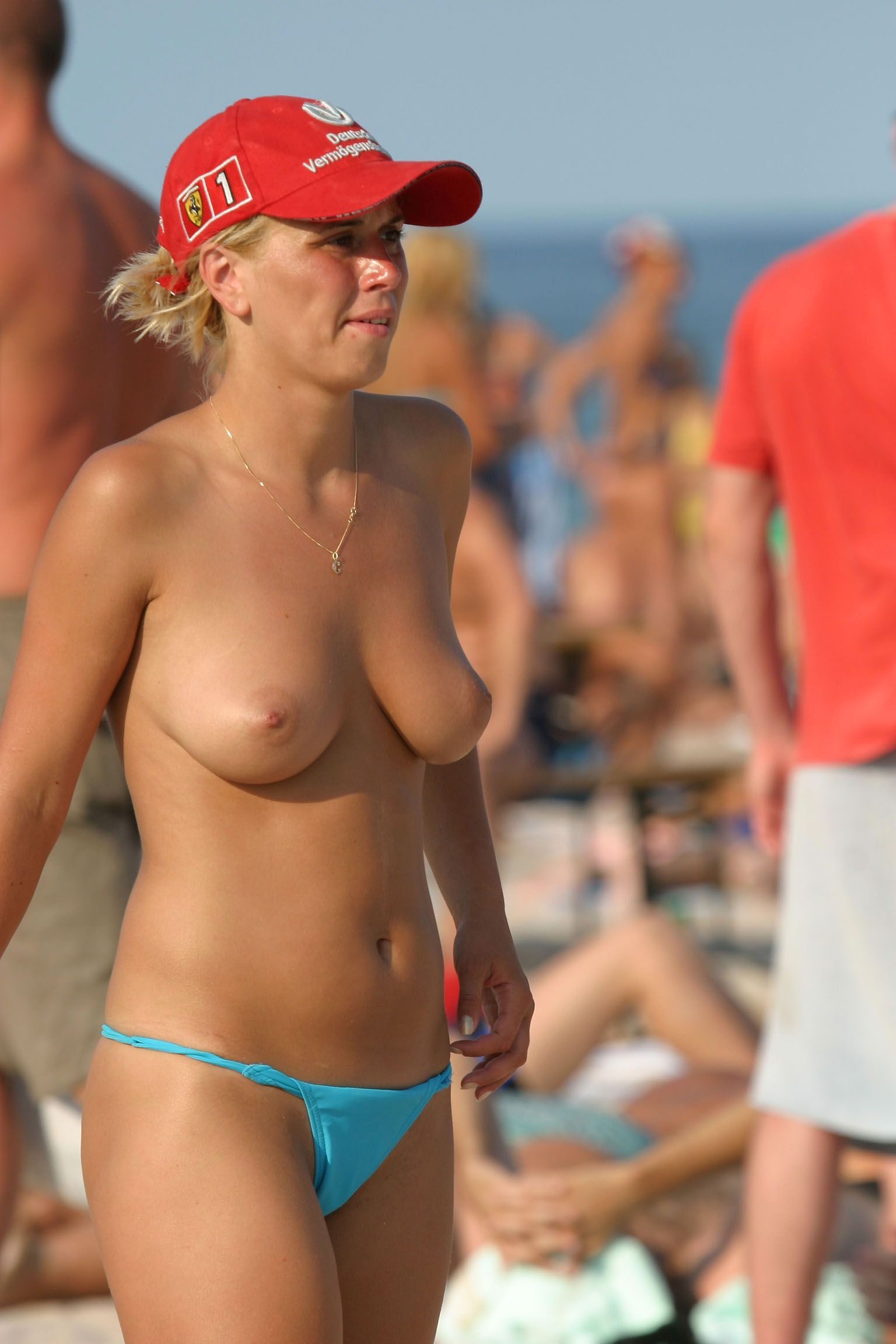 Topless babe show us her red hat