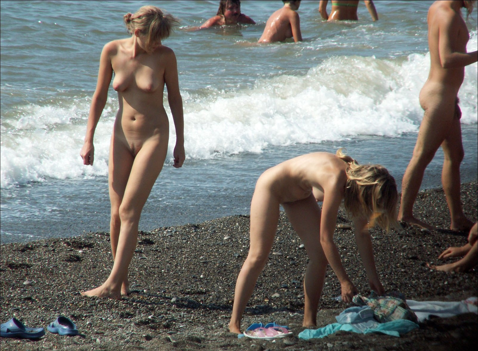 Two blonde cuties enjoying the nude beach