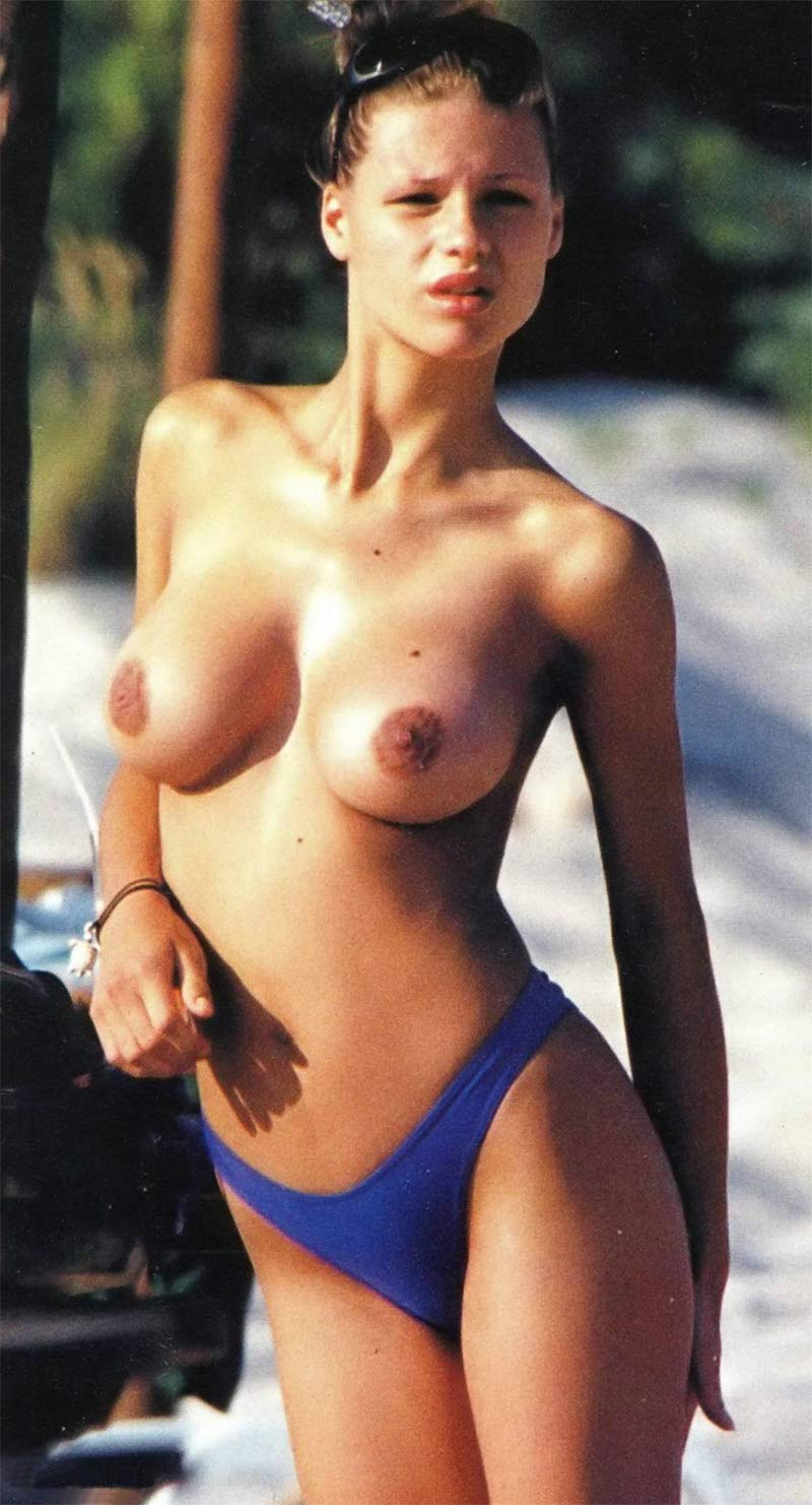 Topless hottie show her brown perky nips