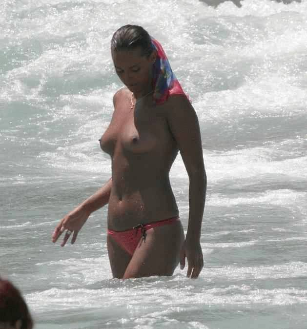 Topless hottie exiting from ocean